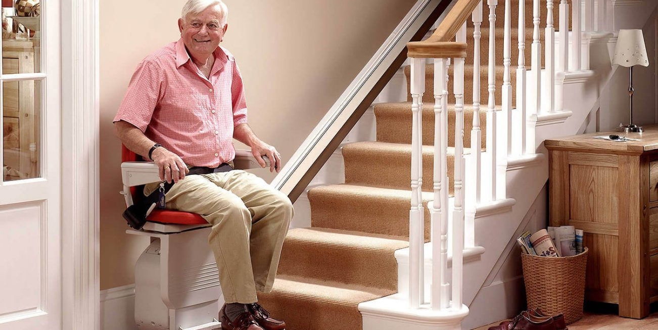 Https://oklahoma.cainsmobility.com/wp Content/uploads/sites/37/2015/12/happy Man Using A  Stair Lift In Broken Arrow
